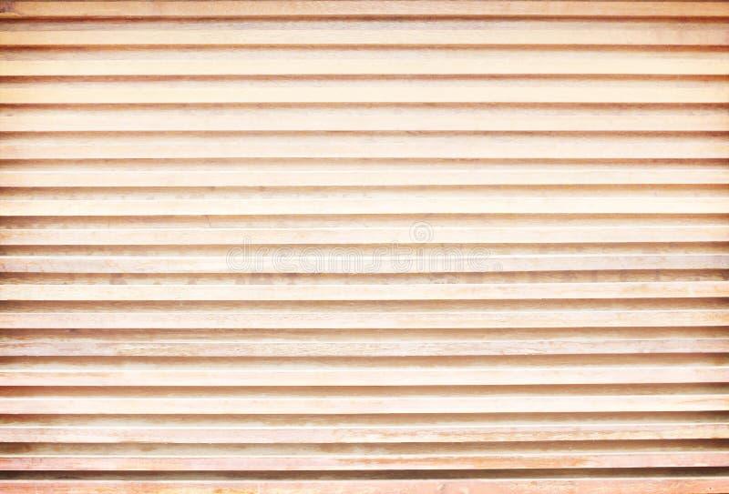 Tranche décorative de modèles brun clair de planche sur la texture en bois de mur pour le fond, horizontale image libre de droits