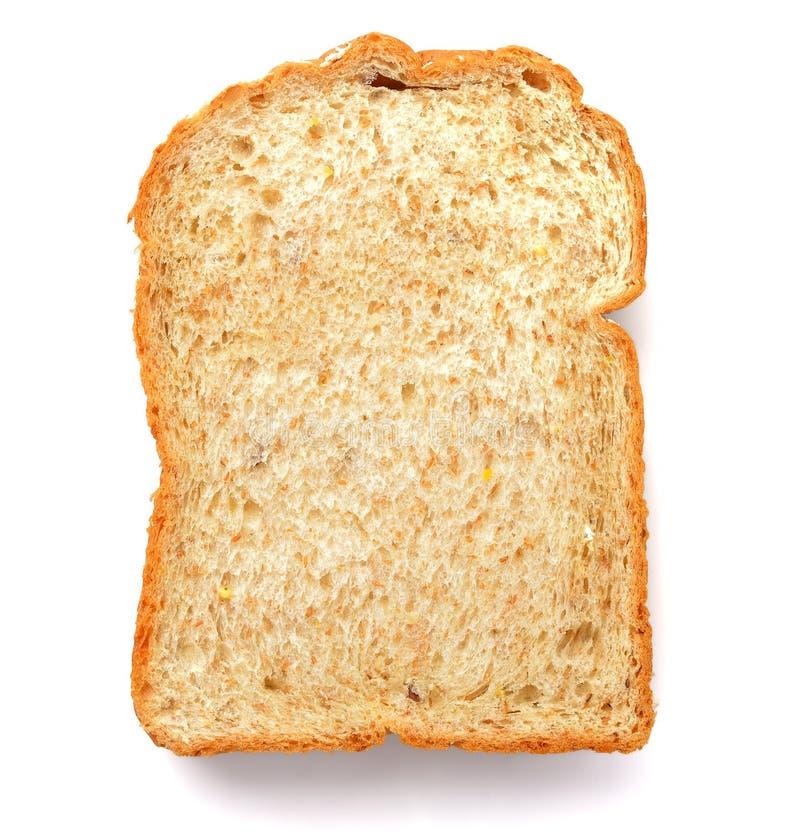Tranche d'un pain de blé entier d'isolement sur un fond blanc photographie stock libre de droits