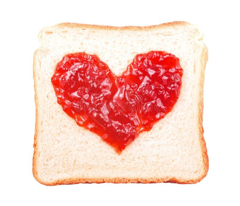 Tranche de pain avec la forme de coeur de confiture de fruit image libre de droits