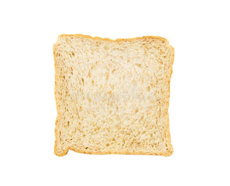 Tranche de pain de blé entier d'isolement sur un fond blanc images stock