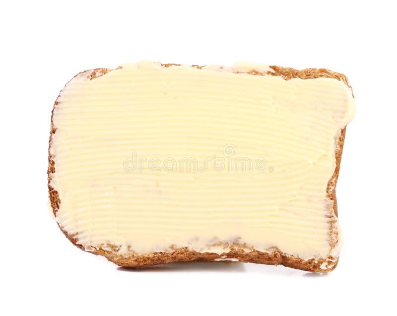 Tranche de pain de seigle avec du beurre images libres de droits