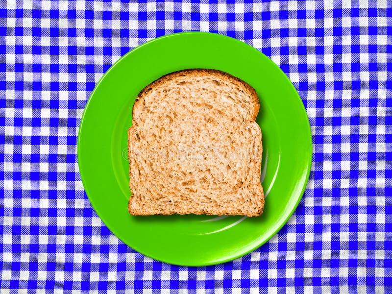 Tranche de pain entier de plat images stock