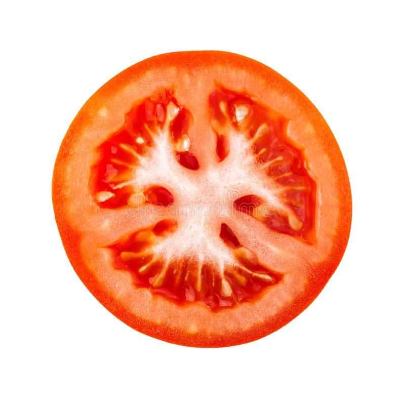Tranche de tomate d'isolement sur le fond blanc images libres de droits