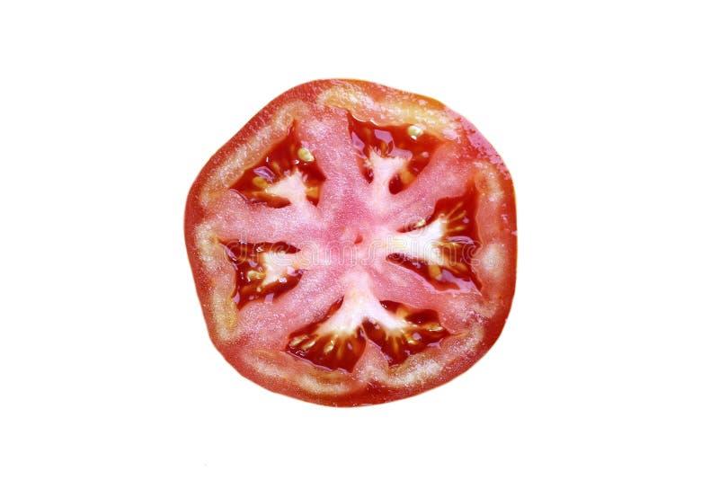 Tranche de tomate d'isolement sur le fond blanc Vue sup?rieure, configuration plate image libre de droits