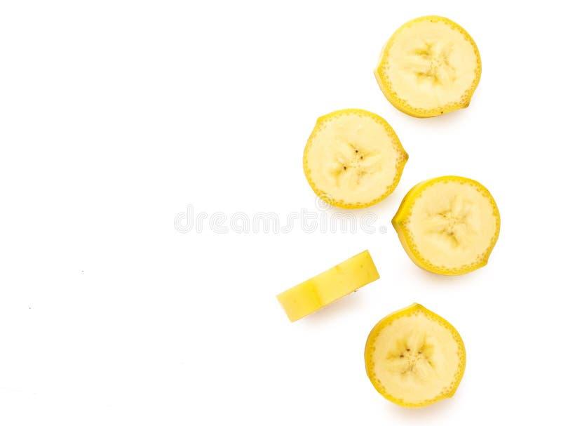 Tranche fraîche de banane de vue supérieure d'isolement sur le fond blanc image libre de droits