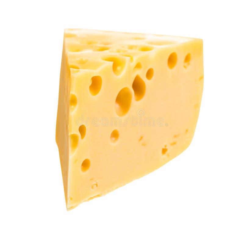 Tranche triangulaire de fromage suisse demi-dur jaune photo libre de droits