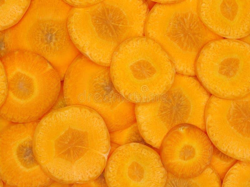 Tranches épluchées crues fraîches de carotte photographie stock