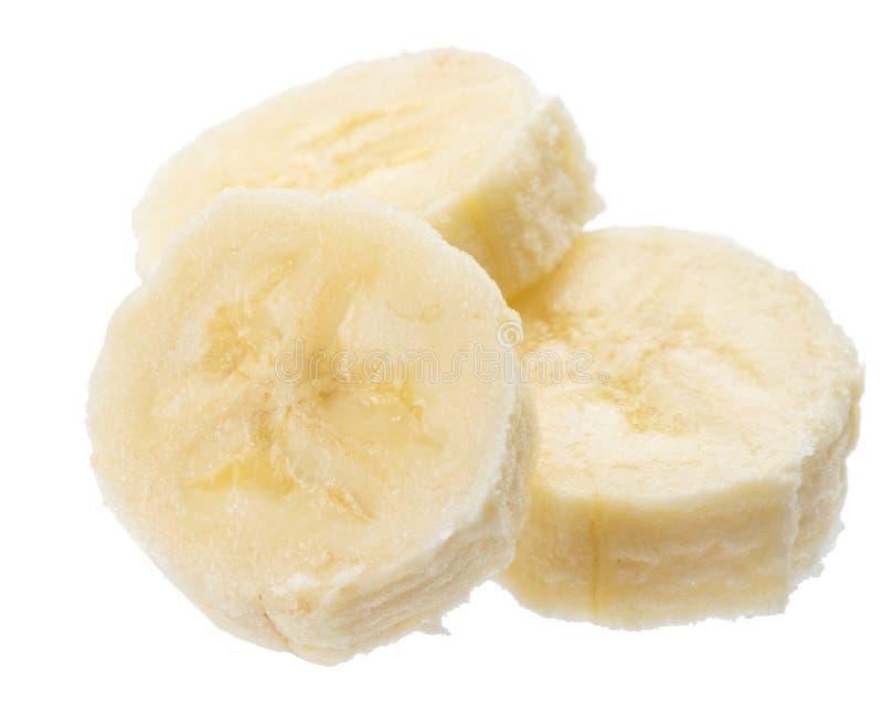 Tranches épluchées de banane sur le fond blanc image stock