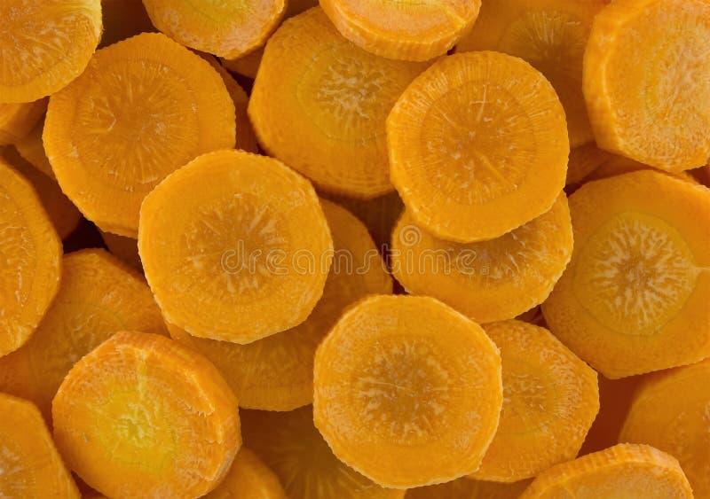 Tranches de carotte comme texture de fond images stock