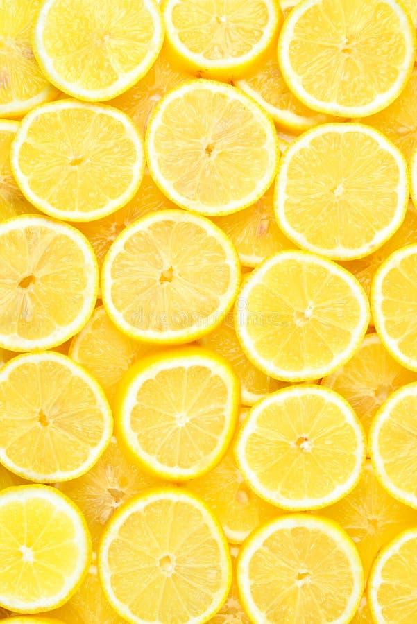 Tranches de citrons jaunes juteux frais Fond de texture, patt images libres de droits