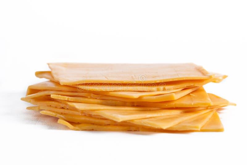 Tranches de fromage de cheddar photo stock