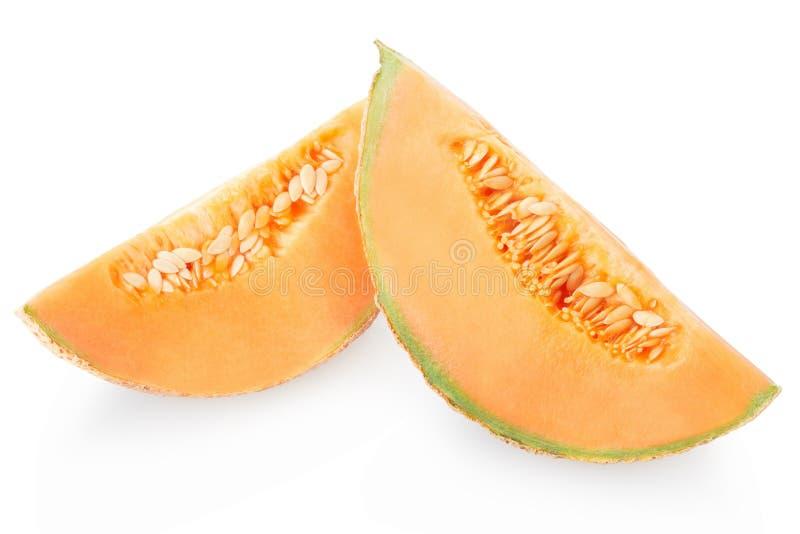 Tranches de melon de cantaloup sur le blanc image libre de droits