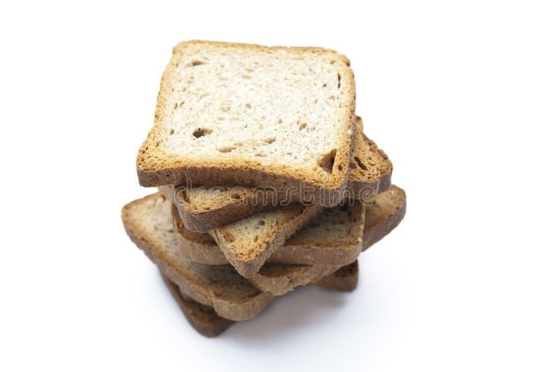 Tranches de pain d'isolement sur le blanc photo stock