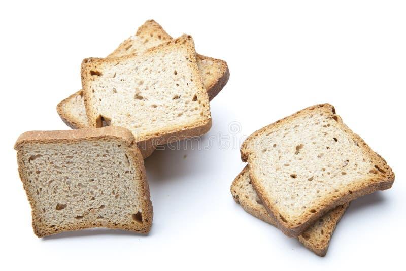 Tranches de pain d'isolement sur le blanc images stock