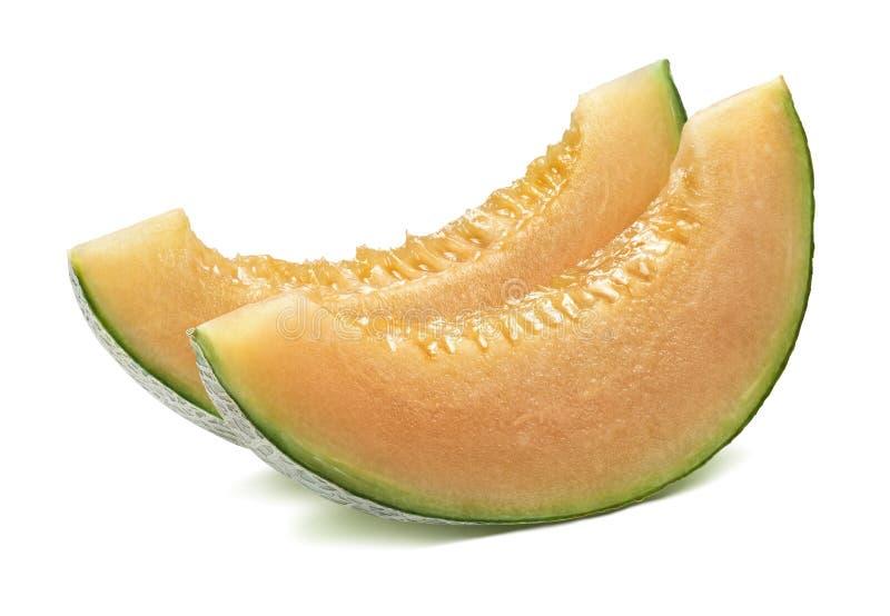 Tranches de parallèle de melon de cantaloup d'isolement sur le blanc photographie stock