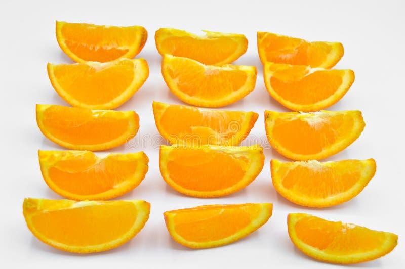 Tranches oranges coup?es fra?ches et juteuses images libres de droits
