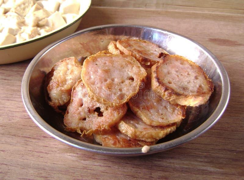 Tranches sautées de petit pain de porc photos stock
