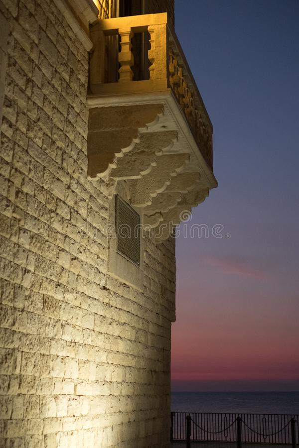Trani Italy. Side view of the Palazzo di Giustizia on Piazza Duomo. Photographed at sunset. Trani, Puglia, Italy. Side view of the Palazzo di Giustizia on stock photo