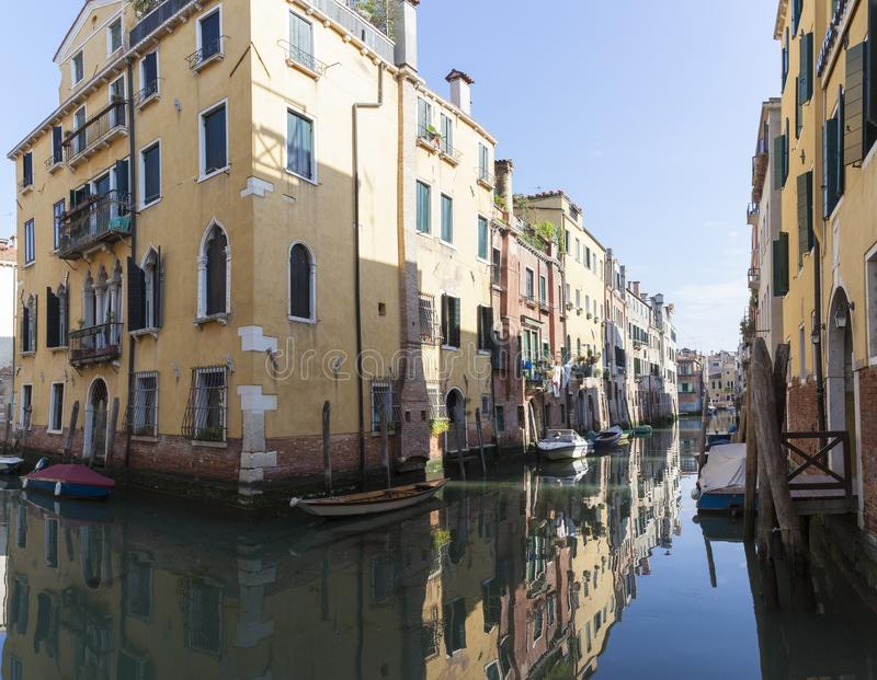 Tranquil back canal, Rio Ca Dolce in Cannaregio, Venice Italy with reflections of historic houses. Tranquil back canal, Rio Ca Dolce,  in Cannaregio, Venice stock image