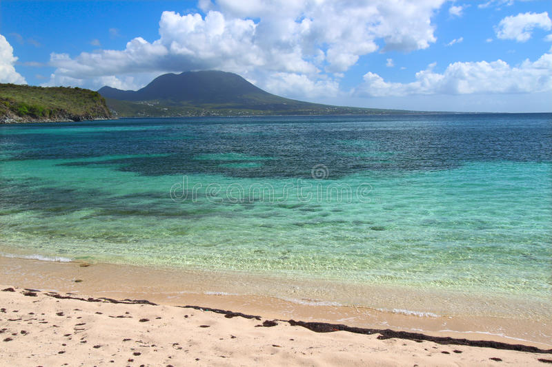 Tranquil beach on Saint Kitts. A tranquil beach and crystal clear water on Saint Kitts stock image
