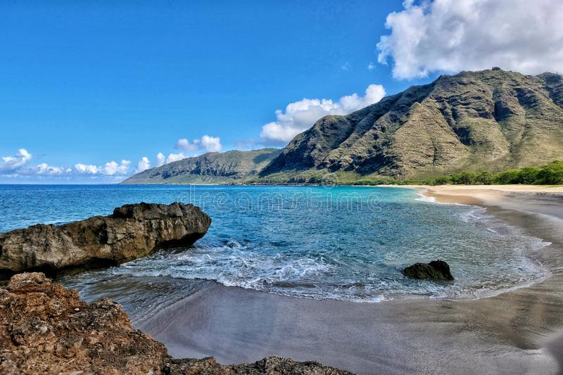 Tranquil calm Hawaii beach stock images