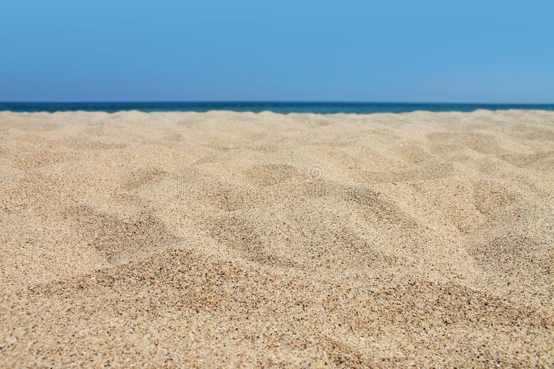 Tranquil empty sandy beach close up. Sea beach background royalty free stock photography