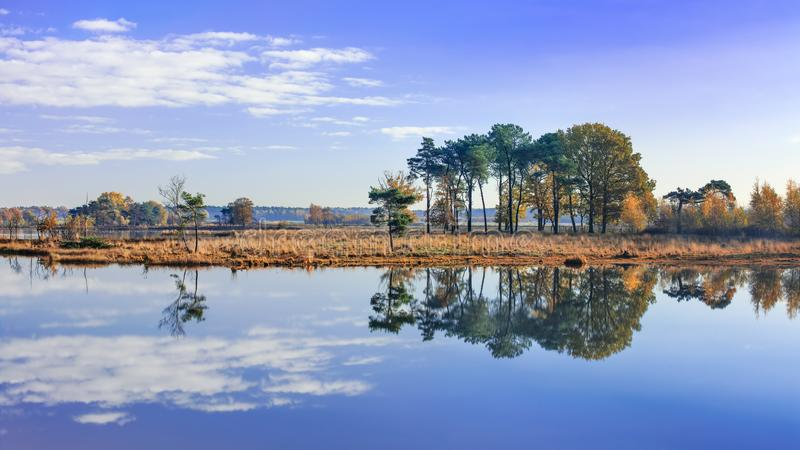Tranquil fens with clouds reflected in calm water, Turnhout, Belgium. Tranquil fens with beautiful shaped clouds reflected in calm water, Turnhout, Belgium royalty free stock images