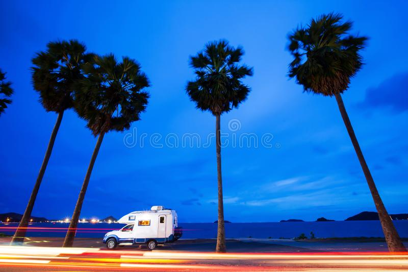 A tranquil journey in motorhome on palm beach road at dusk royalty free stock images