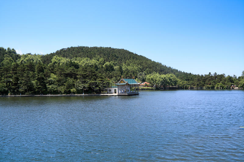Download Tranquil lake and pavilion stock photo. Image of forest - 20187516