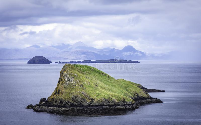 Tranquil landscape of Isle of Skye, Scotland,UK.Small islands on sea and mountains in background stock photos