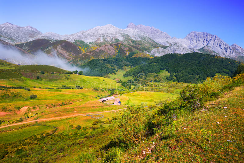 Tranquil mountain landscape. With fog and farm in summer. Leon stock photography