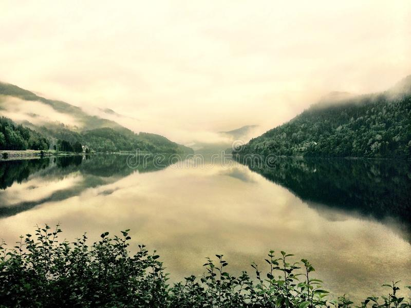 Tranquil mountains meet lake relax still calm stock photo
