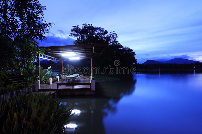 Download Tranquil Night of Water stock image. Image of lamp, cabin - 21205283