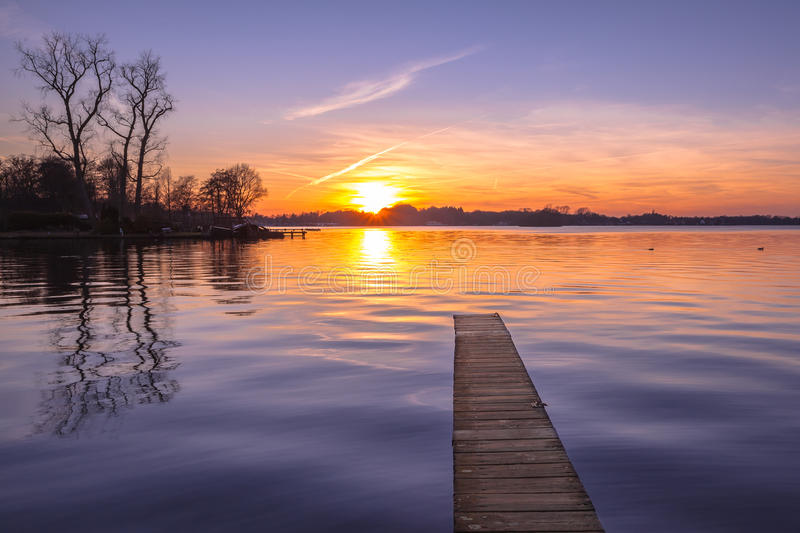 Tranquil purple Sunset over Serene Lake. Tranquil purple Sunset over Serene Water of Lake Paterwoldsemeer, Netherlands royalty free stock photos