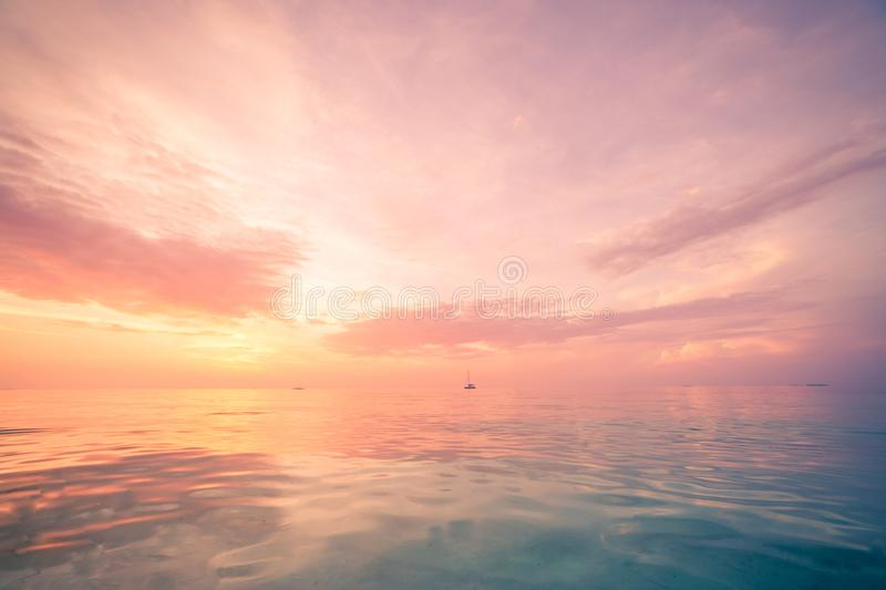 Relaxing and calm sea view. Open ocean water and sunset sky. Tranquil nature background. Infinity sea horizon. Tranquil and relaxing and calm nature sea and sky stock images