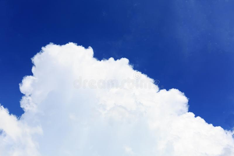Tranquil Scene of Bright White Cloud and Clear Blue Sky royalty free stock images