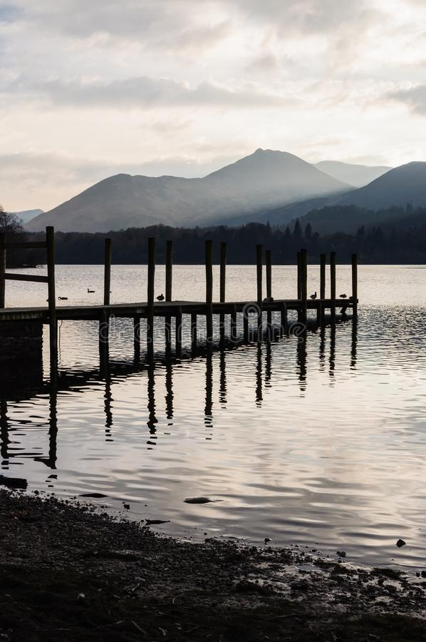Jetty in Lake District Cumbria. Tranquil scene in Lake District Cumbria: Jetty by the lake and mountains in the background stock photos
