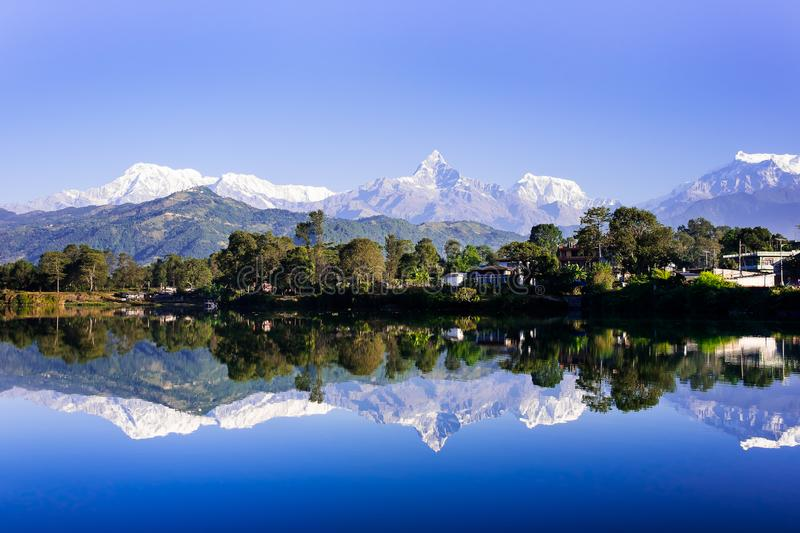 Tranquil scene with the lake and the Himalayan mountains in the background, image with copy space. The place is located in the cit stock images