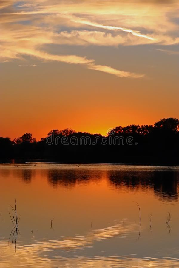 Tranquil Sunset Reflections in the Lake at Dusk royalty free stock image