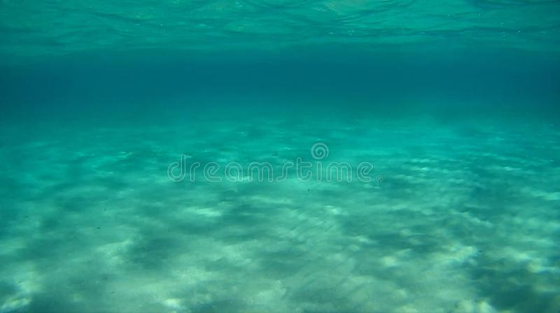 Tranquil underwater scene three color water deep and sand stock image