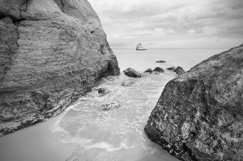 Tranquil view of a coastline landscape in black and white . royalty free stock photos