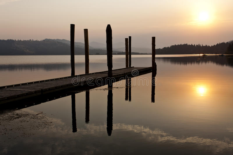 Tranquil warm sunrise over lake. stock photo
