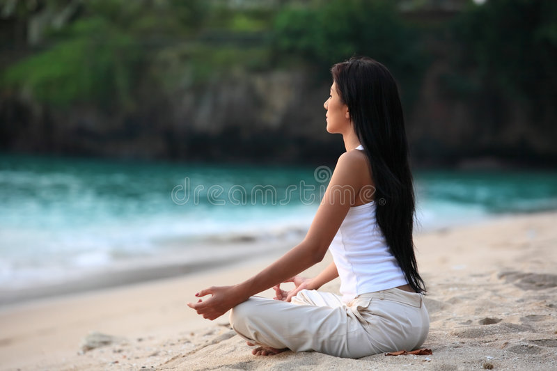 Tranquility. Yoga meditation by the beach royalty free stock image