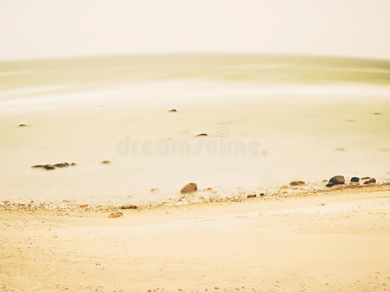 Tranquility and calm long exposure sea.  Natural romantic atmosphere. Tranquility and calm long exposure sea after sunset.  Natural romantic offshore background royalty free stock photography