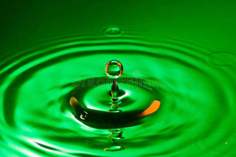 Tranquility conceptual. Perfect droplet splash in a water royalty free stock photos