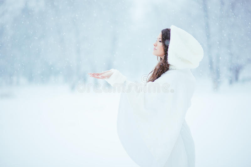 Tranquility. Girl alone in the snow, enjoying the tranquility and quietness of the snowfall stock photos