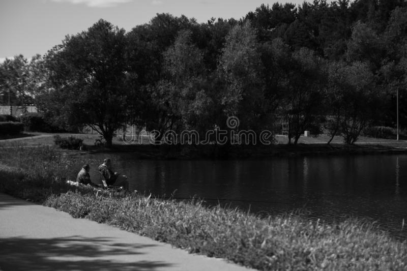 Tranquility. Park, water, fishing, nature royalty free stock photo