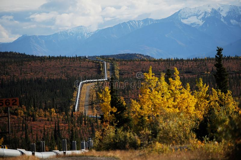 Trans-Alaska oil pipeline with snowy mountained royalty free stock image