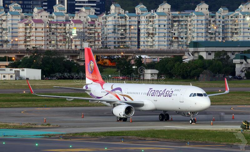 Trans Asia jet on runway stock images