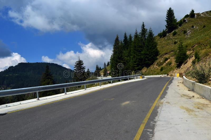 Picturesque places in Romania 3. Trans Bucegi or the Road of Babes takes you to Bucegi Plateau, close to Babele Chalet. The road is accessible by car and offers stock image